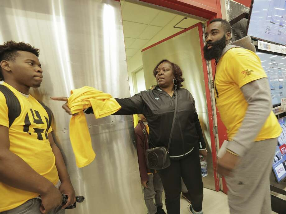 ee137ce189ed Houston Rockets guard James Harden and his mom Monja Willis help children  with a pre-