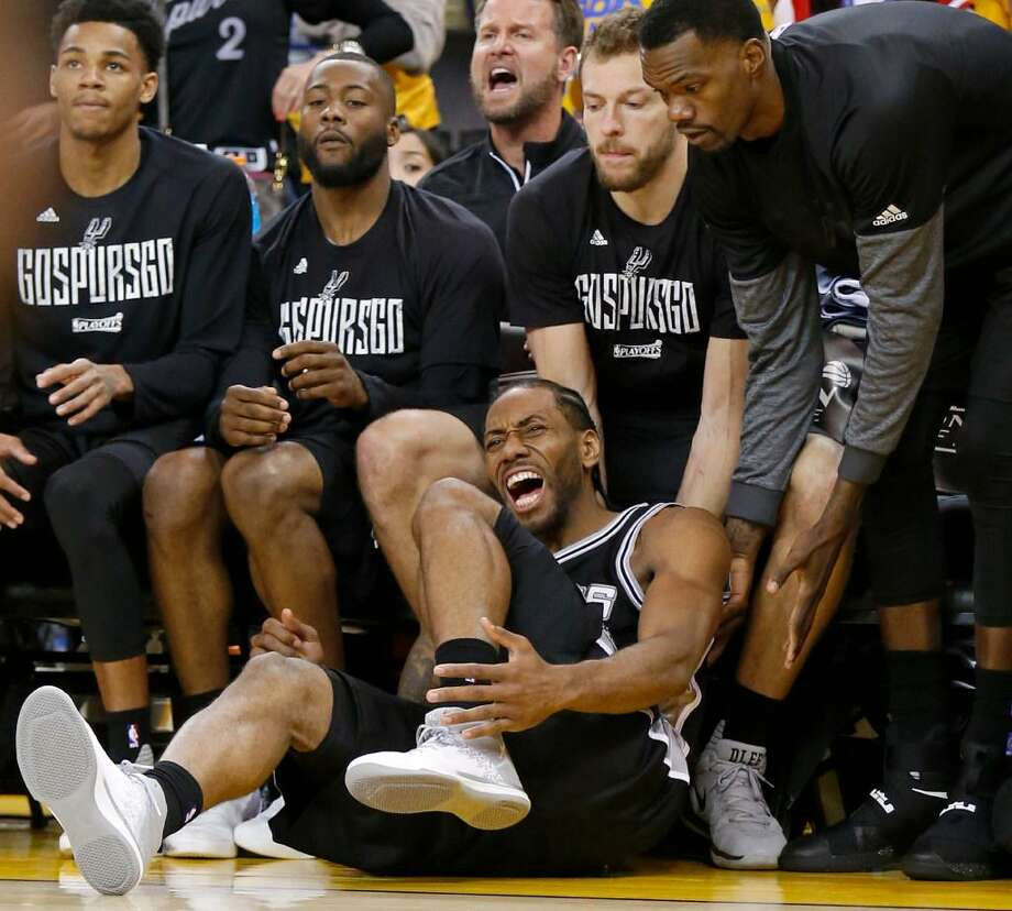 Kawhi Leonard reacts after being injured on a play during second half action of Game 1 in the Western Conference Finals against the Golden State Warriors on May 14, 2017 at Oracle Arena in Oakland, CA. The Warriors won 113-111. Photo: Edward A. Ornelas /Express-News