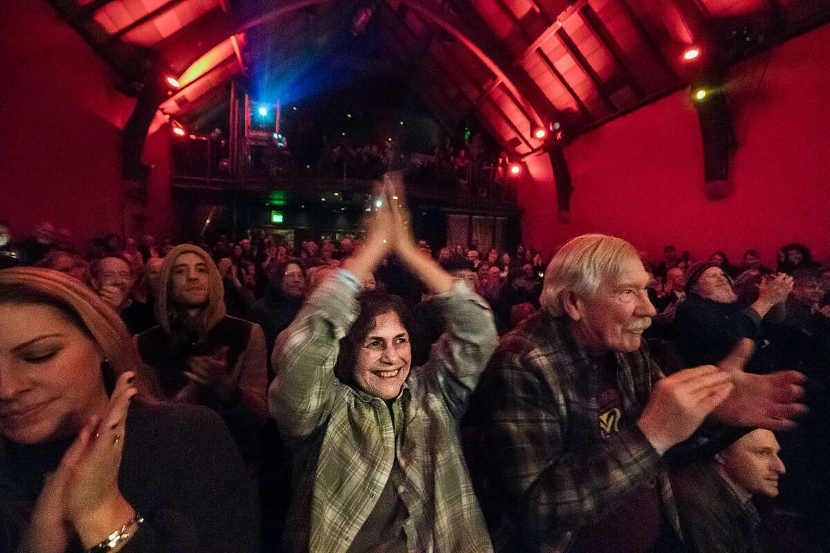 Lynda Lunkley applauds for Country Joe McDonald during a 2017 show in San Francisco, which plans to allow indoor live events to resume on April 15 with limited capacity.