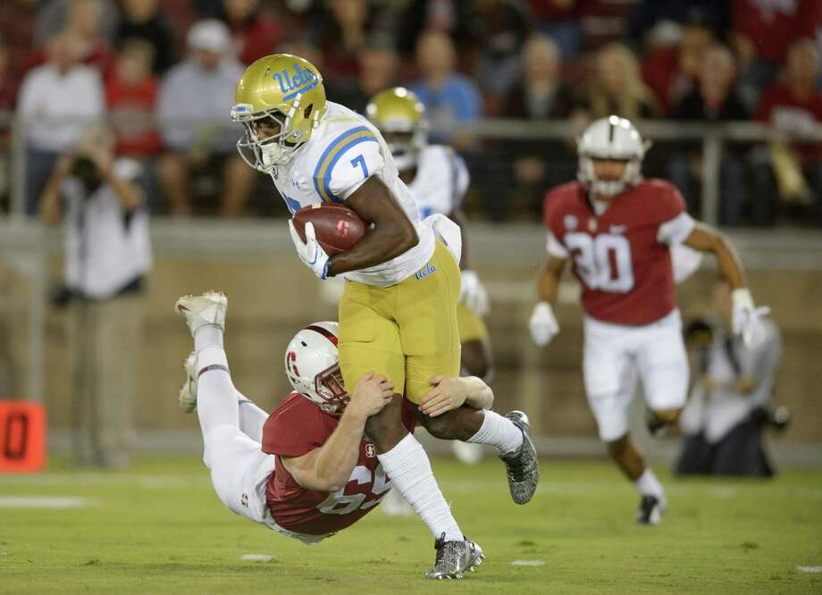 Richard McNitzky makes a tackle during a 58-34 Stanford victory over UCLA at Stanford Stadium. Photo: John Todd /isiphotos.com / John Todd/isiphotos.com