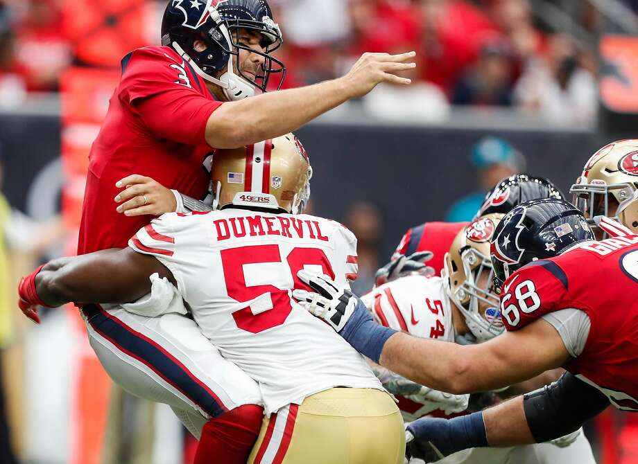 Houston Texans quarterback Tom Savage (3) is hit by San Francisco 49ers defensive end Elvis Dumervil (58) after throwing a pass during the second quarter of an NFL football game at NRG Stadium on Sunday, Dec. 10, 2017, in Houston. ( Brett Coomer / Houston Chronicle ) Photo: Brett Coomer / Houston Chronicle