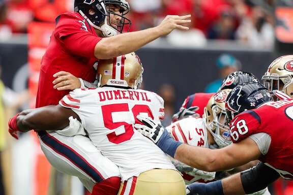 Houston Texans quarterback Tom Savage (3) is hit by San Francisco 49ers defensive end Elvis Dumervil (58) after throwing a pass during the second quarter of an NFL football game at NRG Stadium on Sunday, Dec. 10, 2017, in Houston. ( Brett Coomer / Houston Chronicle )