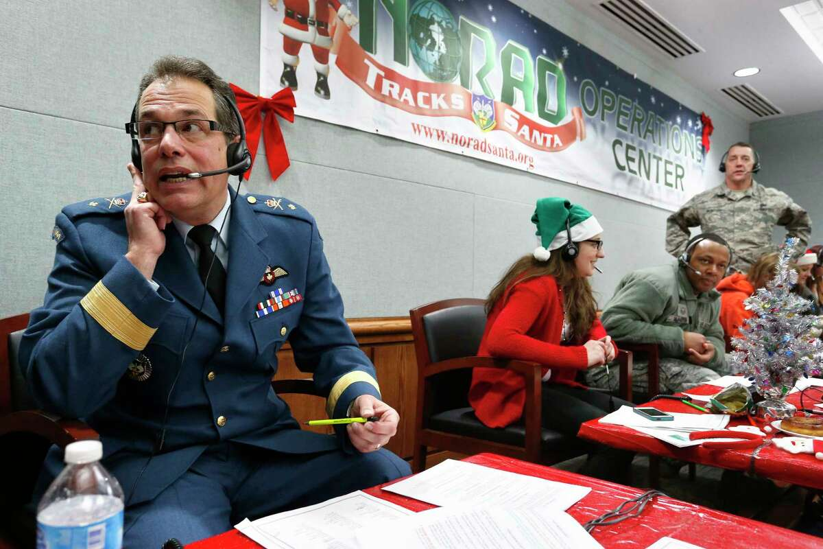 Canadian Brig. Gen. Guy Hamel and volunteers in 2014 take calls from children around the world asking where Santa is and when he will deliver presents.