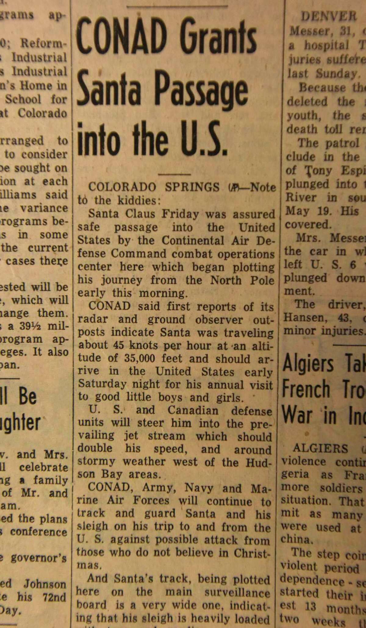 This photo of the front page of The GreeleyTribune in Greeley, Colo., from Dec. 23, 1955, shows an Associated Press story about the Continental Air Defense Command or CONAD tracking Santa Claus. The U.S. military's Santa-tracking program began that year after a newspaper ad invited children to call Santa but inadvertently ran the phone number of CONAD's hotline. Now in its 62nd year, the program is operated by CONAD's successor, the North American Aerospace Defense Command, a U.S.-Canadian military command at Peterson Air Force Base, Colorado. (Josh Polson/The Greeley Tribune via AP)