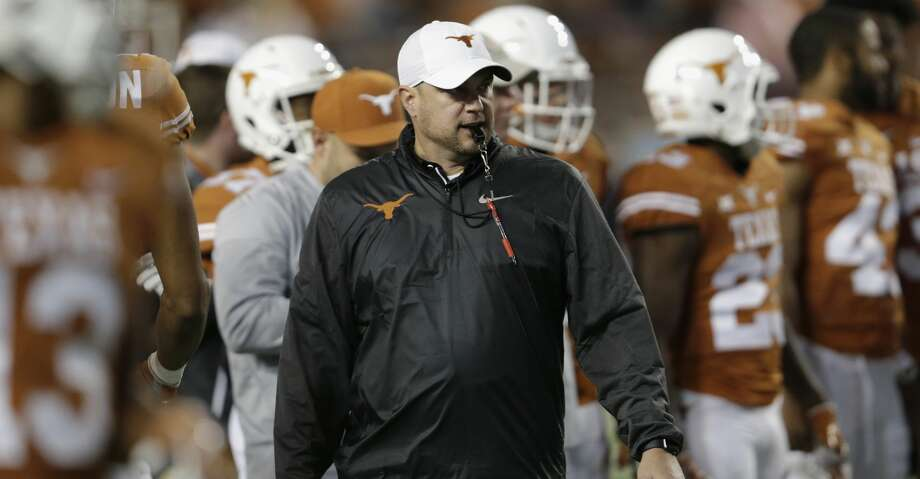 AUSTIN, TX - NOVEMBER 24:  Head coach Tom Herman of the Texas Longhorns  watches players warm up before the game against the Texas Tech Red Raiders at Darrell K Royal-Texas Memorial Stadium on November 24, 2017 in Austin, Texas.  (Photo by Tim Warner/Getty Images) Photo: Tim Warner/Getty Images
