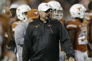 AUSTIN, TX - NOVEMBER 24:  Head coach Tom Herman of the Texas Longhorns  watches players warm up before the game against the Texas Tech Red Raiders at Darrell K Royal-Texas Memorial Stadium on November 24, 2017 in Austin, Texas.  (Photo by Tim Warner/Getty Images)