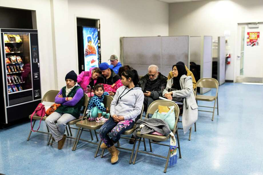 People in a waiting room at a health center in New Jersey where counselors this month were on hand for insurance enrollment. Photo: DEMETRIUS FREEMAN /NYT / NYTNS