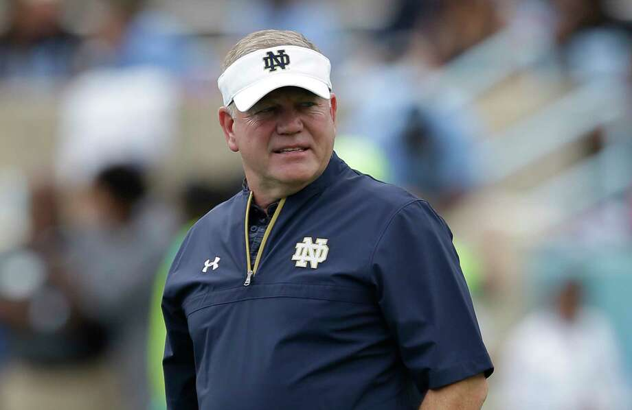 FILE - In this Oct. 7, 2017, file photo, Notre Dame head coach Brian Kelly watches prior to an NCAA college football game against North Carolina in Chapel Hill, N.C. Kelly has to be feeling a bit divided as the Notre Dame head coach prepares the Fighting Irish for their Citrus Bowl clash with No. 16 LSU. (AP Photo/Gerry Broome, File) Photo: Gerry Broome / Copyright 2017 The Associated Press. All rights reserved.