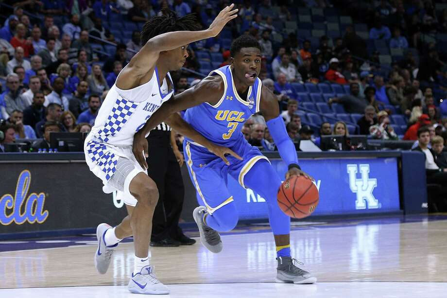 NEW ORLEANS, LA - DECEMBER 23: Aaron Holiday #3 of the UCLA Bruins drives against Shai Gilgeous-Alexander #22 of the Kentucky Wildcats during the first half of the CBS Sports Classic at the Smoothie King Center on December 23, 2017 in New Orleans, Louisiana.  (Photo by Jonathan Bachman/Getty Images) Photo: Jonathan Bachman / 2017 Getty Images
