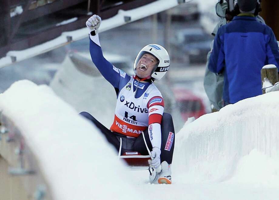 FILE - In this Dec. 17, 2016, file photo, second place finisher Emily Sweeney, of the United States, celebrates as she slides to the finish after a women's World Cup Luge sprint event in Park City, Utah. Sweeney is one of three members of USA Luge's women's team that is headed to Pyeongchang, South Korea, for the winter Olympics.  (AP Photo/Rick Bowmer, File) Photo: Rick Bowmer / Copyright 2016 The Associated Press. All rights reserved.