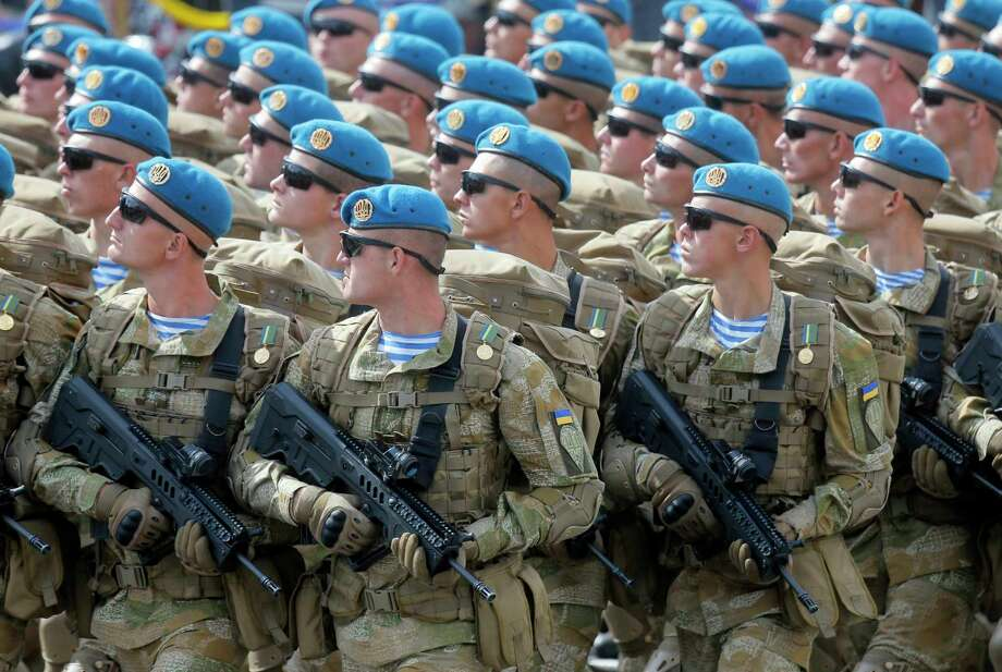 File-This Aug. 24, 2017, file photo shows Ukrainian soldiers marching along main Khreshchatyk Street during a military parade to celebrate Independence Day in Kiev, Ukraine. The Trump administration has approved a plan to provide lethal weapons to Ukraine, including Javelin anti-tank missiles. That's according to several U.S. officials who weren't authorized to discuss the decision publicly and demanded anonymity Friday, Dec. 22, 2017. (AP Photo/Efrem Lukatsky, File) Photo: Efrem Lukatsky / Copyright 2017 The Associated Press. All rights reserved.