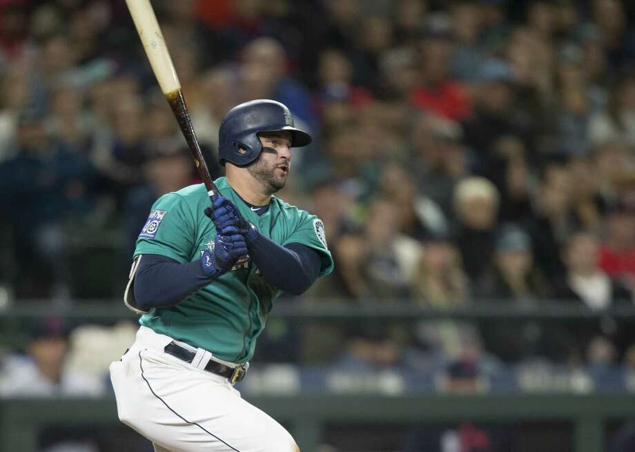 SEATTLE, WA - SEPTEMBER 22: Yonder Alonso #10 of the Seattle Mariners hits a RBI-single off of starting pitcher Trevor Bauer #47 of the Cleveland Indians that scored Kyle Seager #15 of the Seattle Mariners during the seventh inning of a game at Safeco Field on September 22, 2017 in Seattle, Washington. (Photo by Stephen Brashear/Getty Images) ORG XMIT: 700012563 Photo: Stephen Brashear / 2017 Getty Images