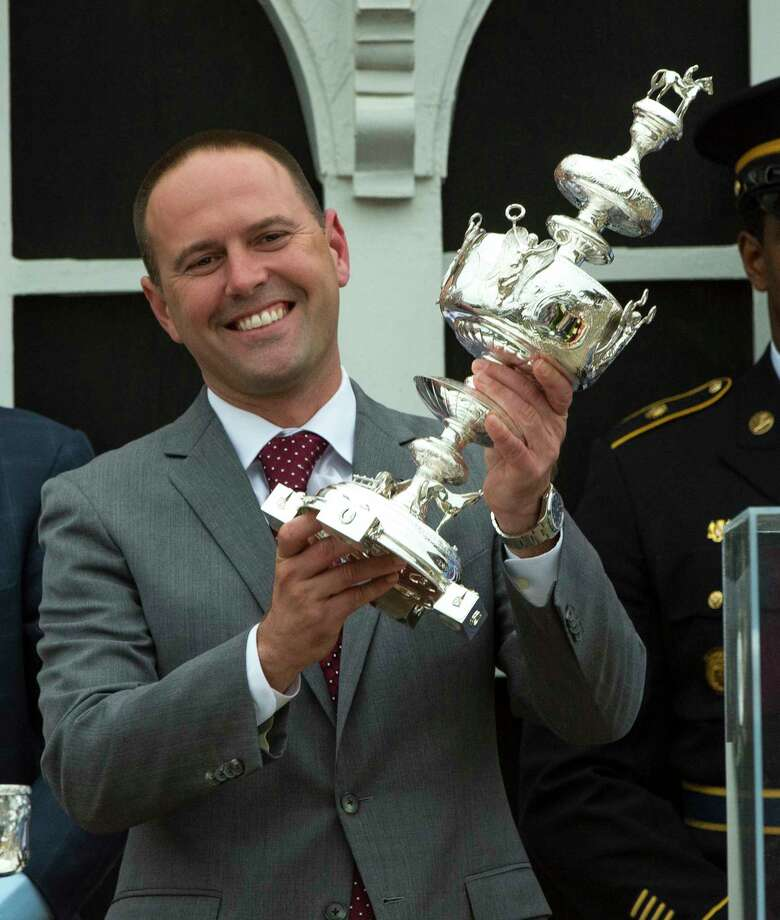 Cloud Computing's trainer Chad Brown holds the winner's trophy aloft after winning the 142nd running of the Preakness Stakes Saturday May 20, 2017 at Pimlico Race Course in Baltimore, MD  (Skip Dickstein/Times Union) Photo: SKIP DICKSTEIN