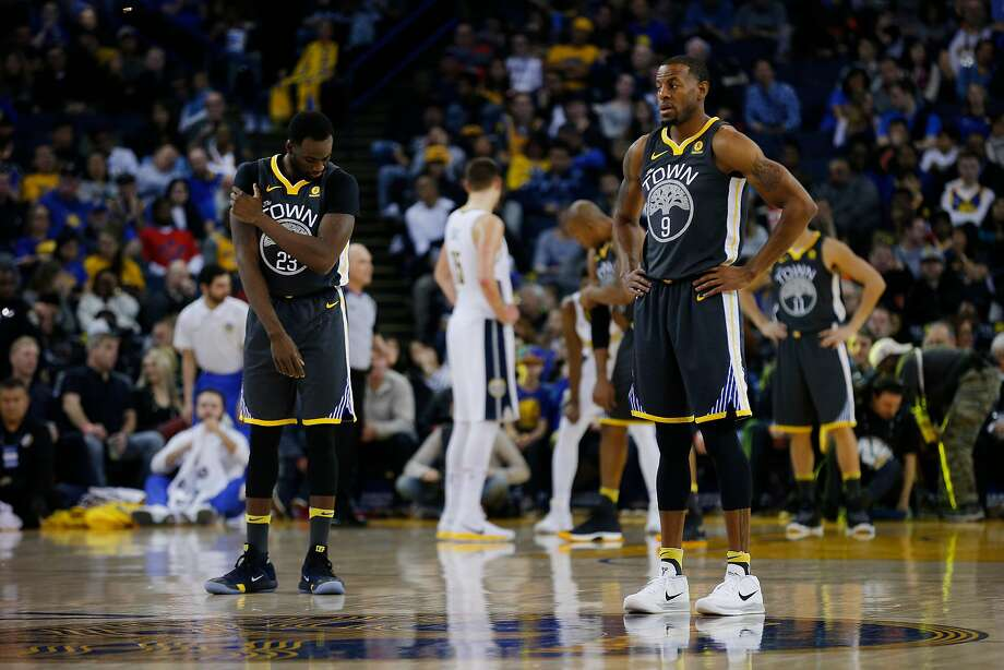 Golden State Warriors forward Draymond Green (23) and Golden State Warriors forward Andre Iguodala (9) during the first half of an NBA basketball game between the Golden State Warriors and the Denver Nuggets at Oracle Arena on Saturday, Dec. 23, 2017 in Oakland, Calif. The Nuggets lead 53-41 at half. Photo: Santiago Mejia, The Chronicle