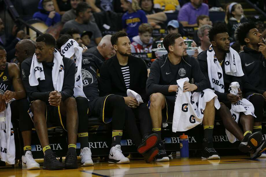 Golden State Warriors guard Stephen Curry (30) watches from the bench during the first half of an NBA basketball game between the Golden State Warriors and the Denver Nuggets at Oracle Arena on Saturday, Dec. 23, 2017 in Oakland, Calif. The Nuggets lead 53-41 at half. Photo: Santiago Mejia, The Chronicle