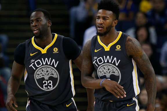 Golden State Warriors forward Draymond Green (23) and Golden State Warriors forward Jordan Bell (2) during the first half of an NBA basketball game between the Golden State Warriors and the Denver Nuggets at Oracle Arena on Saturday, Dec. 23, 2017 in Oakland, Calif. The Nuggets lead 53-41 at half.