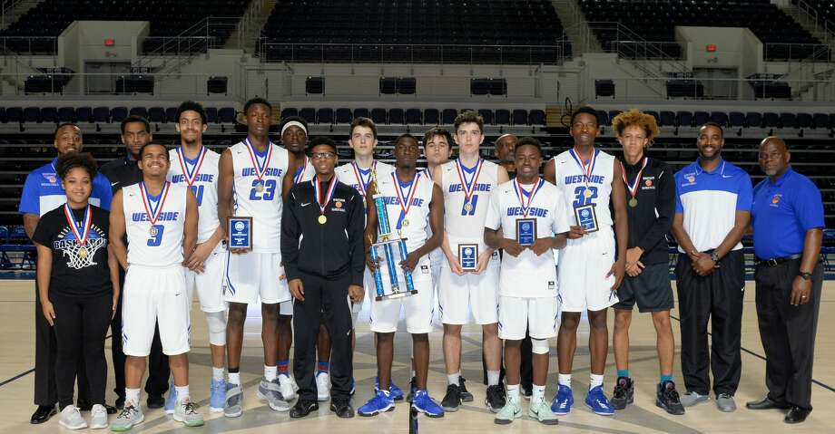 The Westside Wolves pose after winning the championship game in the Houston ISD Varsity Boys Tournament by beating the Lamar Texans on Saturday December 23, 2017 at Delmar Fieldhouse, Houston, TX. Photo: Craig Moseley/Houston Chronicle