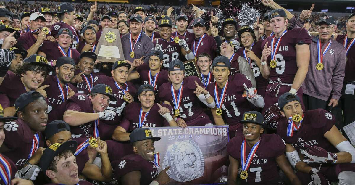 Cy-Fair coaches and players pose for a photo with the state title plaque after winning the Class 6A Division II State Championship Game at AT&T Stadium on Saturday, Dec. 23, 2017, in Arlington. The Cy-Fair Bobcats defeated the Waco Midway Panthers 51-35 and won the state championship title. ( Yi-Chin Lee / Houston Chronicle )