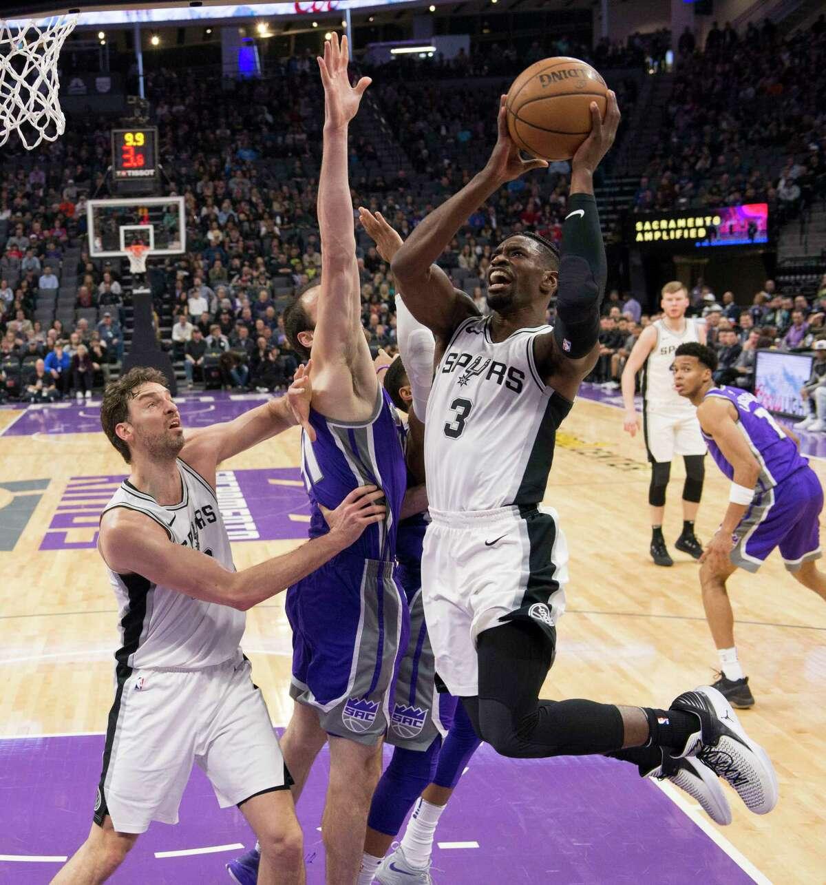 San Antonio Spurs guard Brandon Paul (3) goes to the basket against the Sacramento Kings center Kosta Koufos (41) in the first quarter on Monday, Jan. 8, 2018 at the Golden 1 Center in Sacramento, Calif.