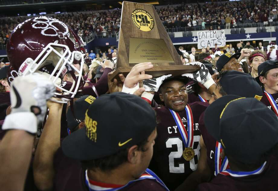Cy-Fair Marcus McKinley (28) helps holding the state title plaque during celebrationg after winning the Class 6A Division II State Championship Game at AT&T Stadium on Saturday, Dec. 23, 2017, in Arlington. The Cy-Fair Bobcats defeated the Waco Midway Panthers 51-35 and won the state championship title. ( Yi-Chin Lee / Houston Chronicle ) Photo: Yi-Chin Lee/Houston Chronicle