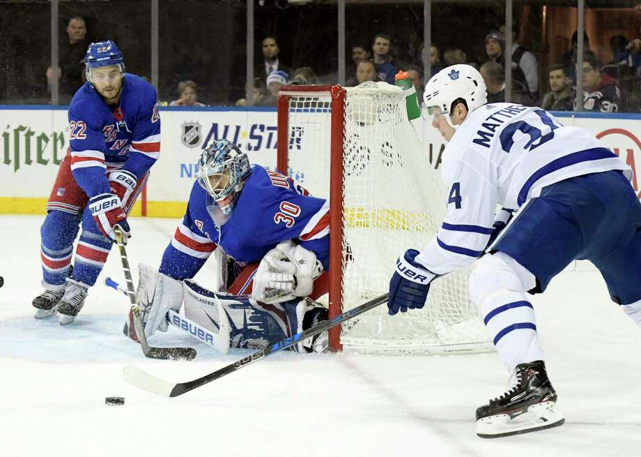 Toronto Maple Leafs center Auston Matthews (34) skates after the puck as New York Rangers goalie Henrik Lundqvist (30) protects the net and Rangers defenseman Kevin Shattenkirk (22) helps out during the first period of an NHL hockey game Saturday, Dec. 23, 2017, at Madison Square Garden in New York. (AP Photo/Bill Kostroun) Photo: Bill Kostroun / FR51951 AP