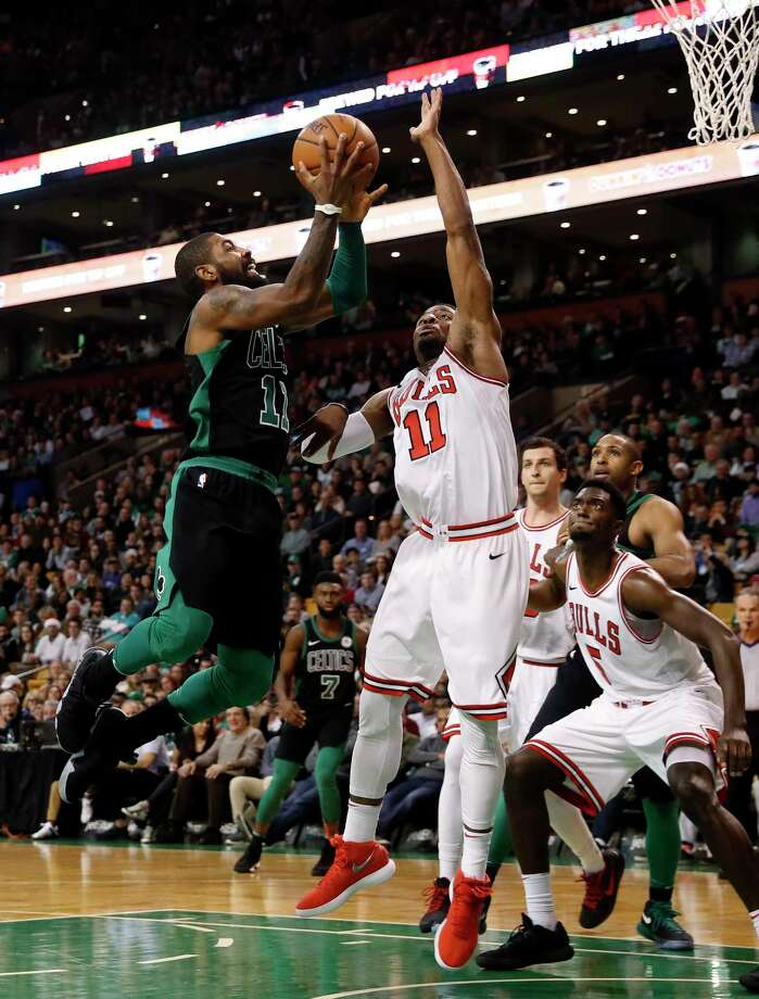 Boston Celtics' Kyrie Irving goes to the basket against Chicago Bulls' David Nwaba during the second quarter of Boston's 117-92 win in an NBA basketball game in Boston on Saturday, Dec. 23, 2017. (AP Photo/Winslow Townson) Photo: Winslow Townson / FR170221 AP