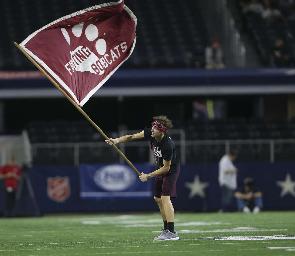 Cy-Fair's flag bearer celebrates the team's touchdown during the third quarter of the Class 6A Division II State Championship Game against Waco Midway at AT&T Stadium on Saturday, Dec. 23, 2017, in Arlington. ( Yi-Chin Lee / Houston Chronicle )