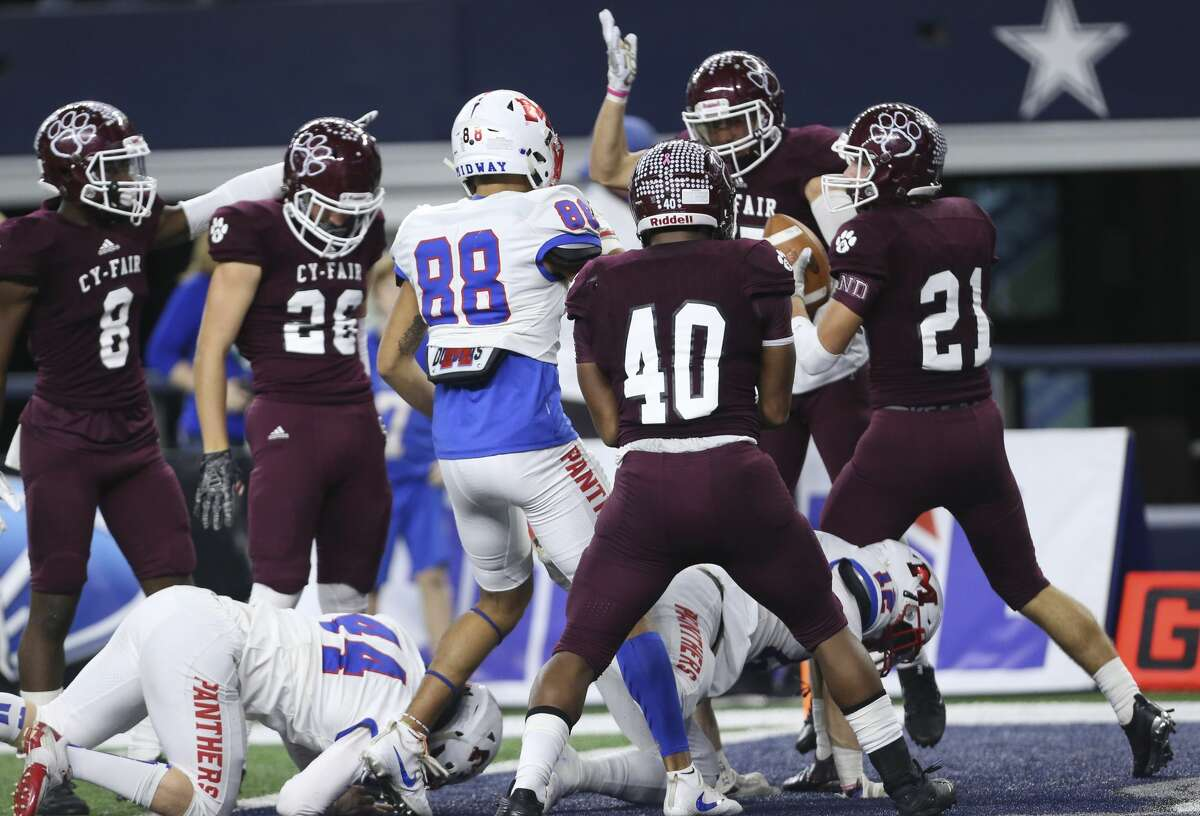 Cy-Fair players celebrate Cody Cunninghm recovered the ball from Waco Midway during the third quarter of the Class 6A Division II State Championship Game at AT&T Stadium on Saturday, Dec. 23, 2017, in Arlington. ( Yi-Chin Lee / Houston Chronicle )