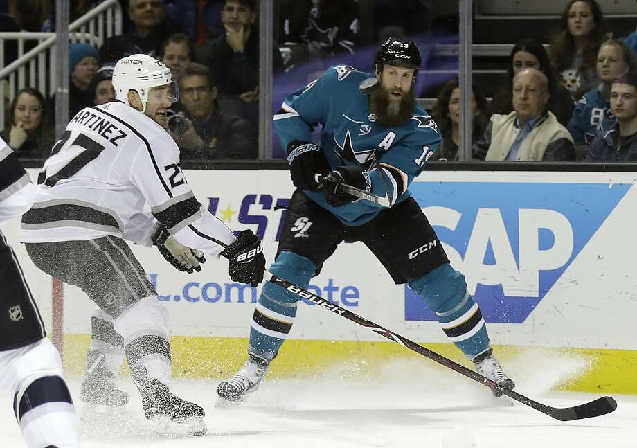San Jose center Joe Thornton, right, passes as Los Angeles defenseman Alec Martinez closes in during the first period Saturday night in San Jose's 2-0 win over the division-rival Kings. Photo: Marcio Jose Sanchez, Associated Press