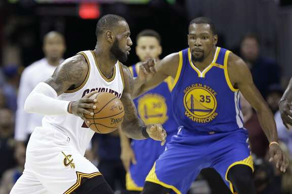 FILE - In this June 9, 2017 file photo, Cleveland Cavaliers forward LeBron James (23) drives on Golden State Warriors forward Kevin Durant (35) during the second half of Game 4 of basketball's NBA Finals in Cleveland. The NBA is driven by star power and its Christmas Day lineup is about the league�s best players, not all the best teams. Yes, the NBA will roll out LeBron James and Kevin Durant, toss in some Russell Westbrook and James Harden under the mistletoe. (AP Photo/Tony Dejak, File)