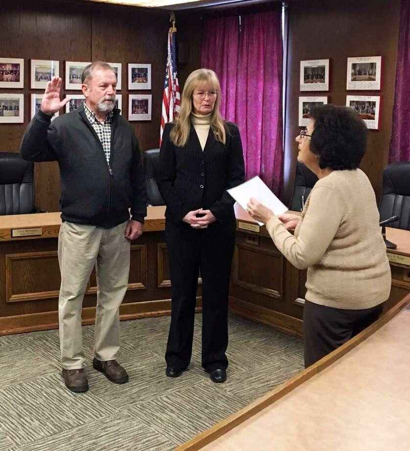 West Haven Assistant City Clerk Sharon Recchia swears in new tree warden Leo Kelly on Dec. 20, 2017 in City Hall as Mayor Nancy Rossi looks on. Kelly previously held the post in 2013-14. Photo: Contributed Photo / Louis P. Esposito Jr., City Of West Haven