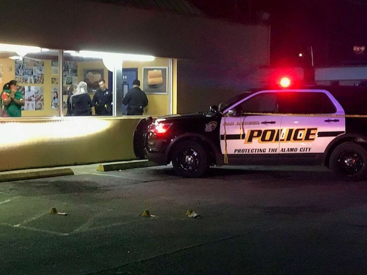 San Antonio police investigate a shooting outside a Church's Chicken in the 2400 block of Basse Road on Saturday, Dec. 23, 2017. A deaf man was shot in an attempted robbery, police said.