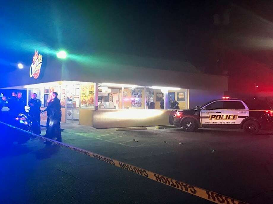 San Antonio police investigate a shooting outside a Church's Chicken in the 2400 block of Basse Road on Saturday, Dec. 23, 2017. A deaf man was shot in an attempted robbery, police said. Photo: Alexandro Luna / San Antonio Express-News