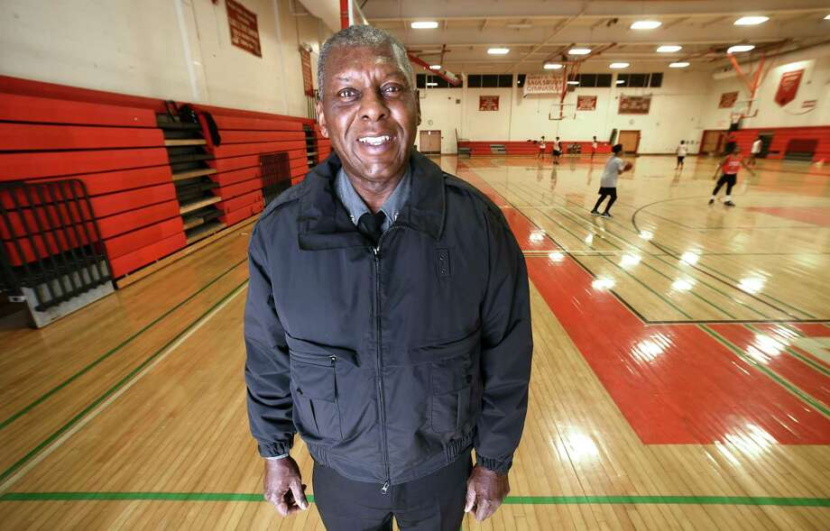 Neil Richardson, founder of the Robert Saulsbury Basketball Invitational, is photographed at the Wilbur Cross High School gymnasium, which has been named after Saulsbury, in New Haven on Dec. 12. Photo: Arnold Gold / Hearst Connecticut Media / New Haven Register