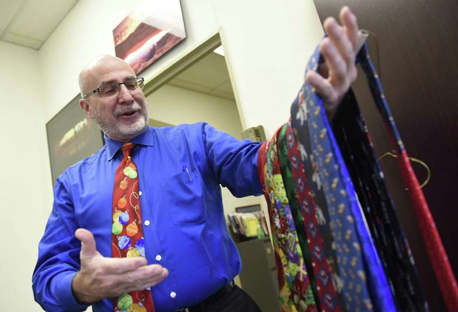 Greenwich Public Schools Human Resources Director Bob Stacey shows his holiday tie collection in his office at the Board of Education building in Greenwich on Wednesday. Photo: Tyler Sizemore / Hearst Connecticut Media / Greenwich Time