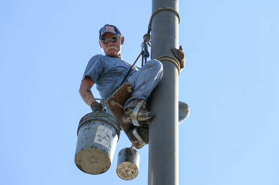 Steve Gooding, 66, has worked as a Texas flagpole painter for 40 years. (Joshua Guerra / For the Houston Chronicle)