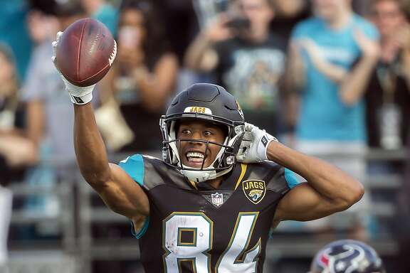 Jacksonville Jaguars wide receiver Keelan Cole (84) celebrates his 9-yard touchdown on a pass play against the Houston Texans during the first half of an NFL football game, Sunday, Dec. 17, 2017, in Jacksonville, Fla. (AP Photo/Stephen B. Morton)