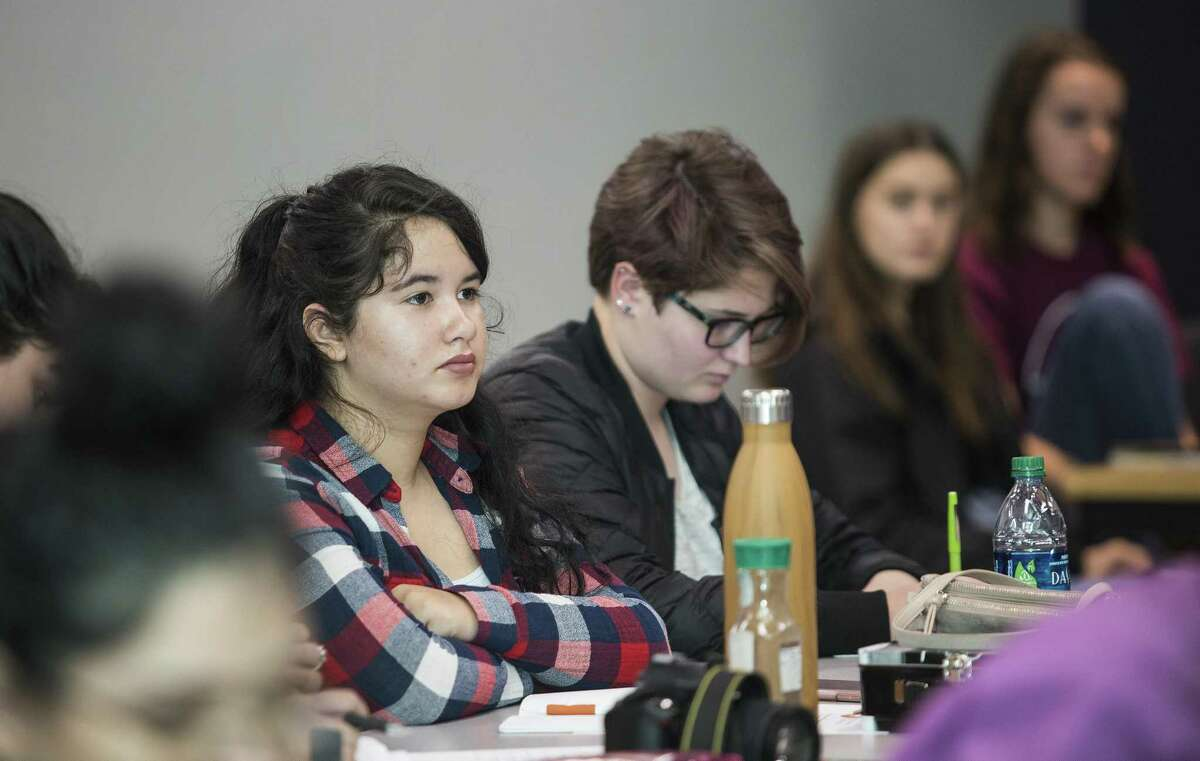 Sophomore Starine Reyes listens to a lecture during a NEISD's International School of the America field trip for their study in energy policy at the Bureau of Economic Geology in Austin, Texas on November 8, 2017.
