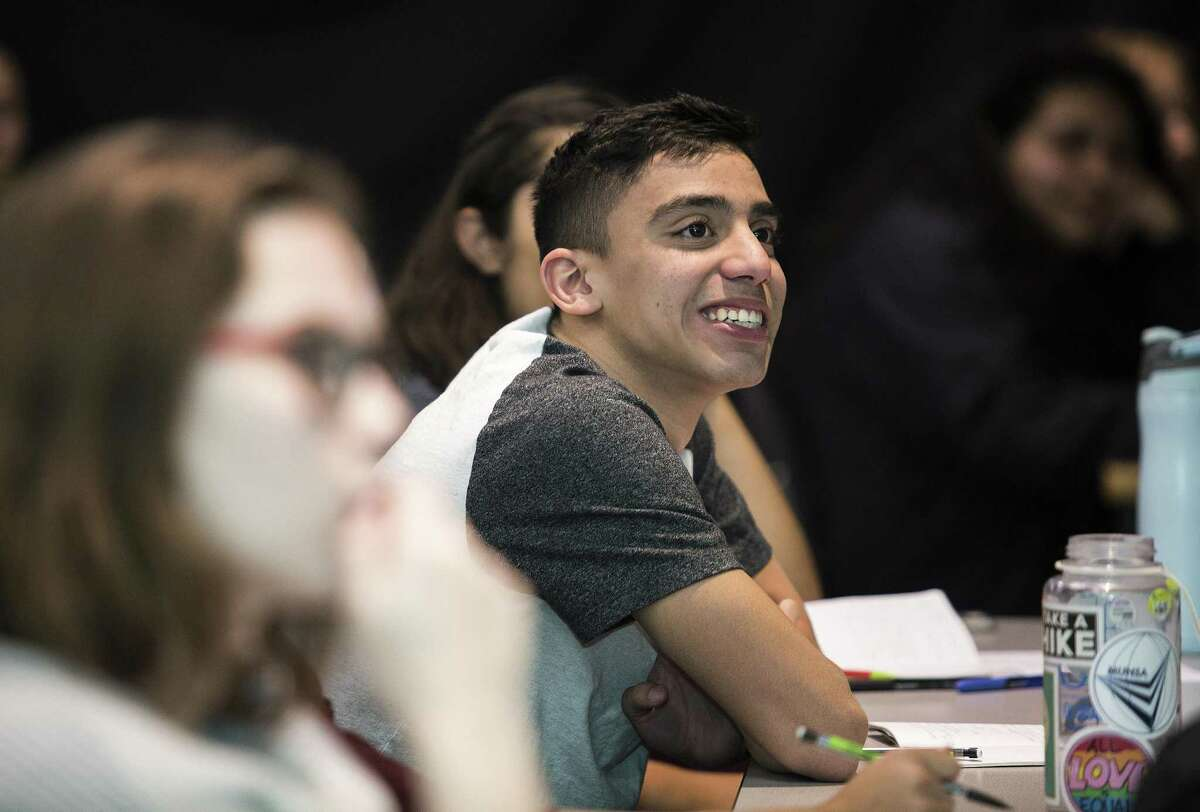 Junior Aidan Cruz listens to a lecture during a NEISD's International School of the America field trip for their study in energy policy at the Bureau of Economic Geology in Austin, Texas on November 8, 2017.