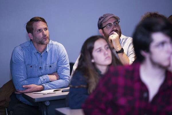 Ryan Sprott, a teacher at NEISD's International School of the America, sits beside Jason Reed, a photo professor at Texas State as the listen lectures as part of a humanities elective where the class focuses on educating students on polarizing contemporary issues through hands-on and project-based learning with the focus being on energy policy this year. The class paid a visit to the Bureau of Economic Geology in Austin, Texas on November 8, 2017 for a field trip to meet with and hear from researchers in the field.