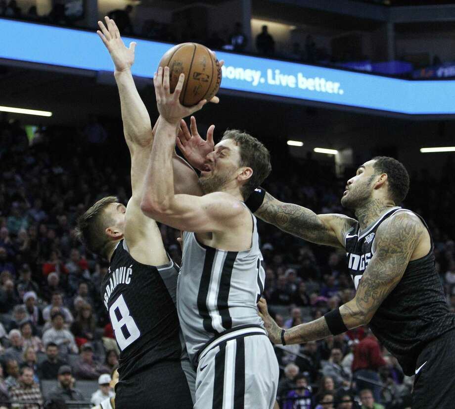 Pau Gasol, attempting to shoot between Bogdan Bogdanovic (left) and center Willie Cauley Stein, finished with 14 points, 11 rebounds and 10 assists. Photo: Steve Yeater / Associated Press / FR69238 AP