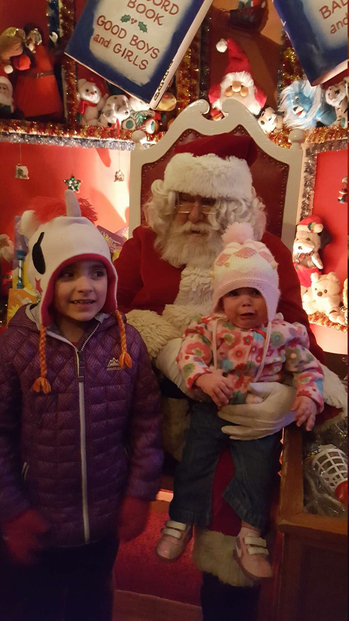 Alyssa (left) 6 years old, and Juliet (right) 9 months old from Newtown, Conn. meet with Santa Claus at Christmas Village in Torrington, Conn.