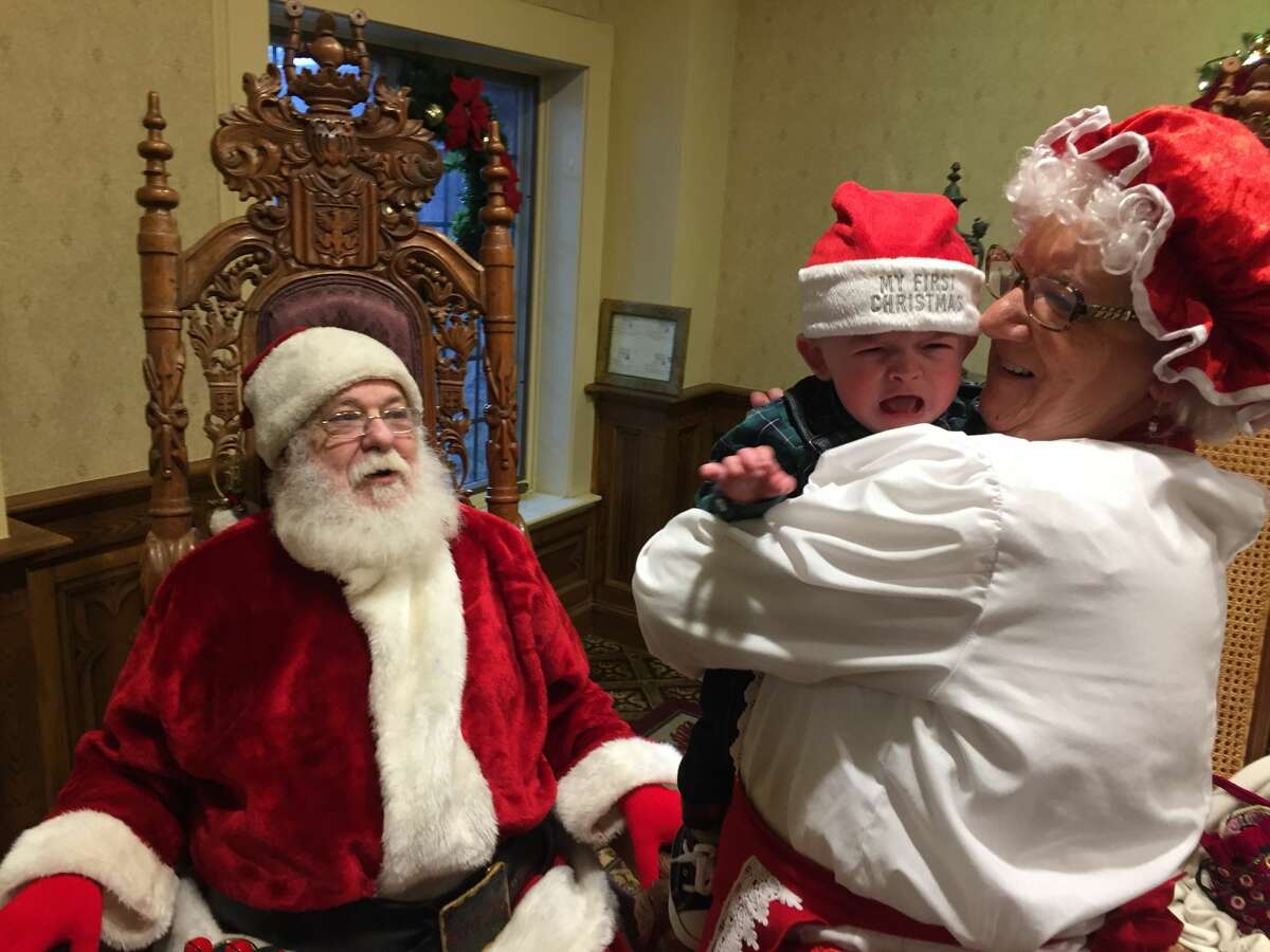 Cooper Tangredi meets Santa and Mrs. Claus for the first time.