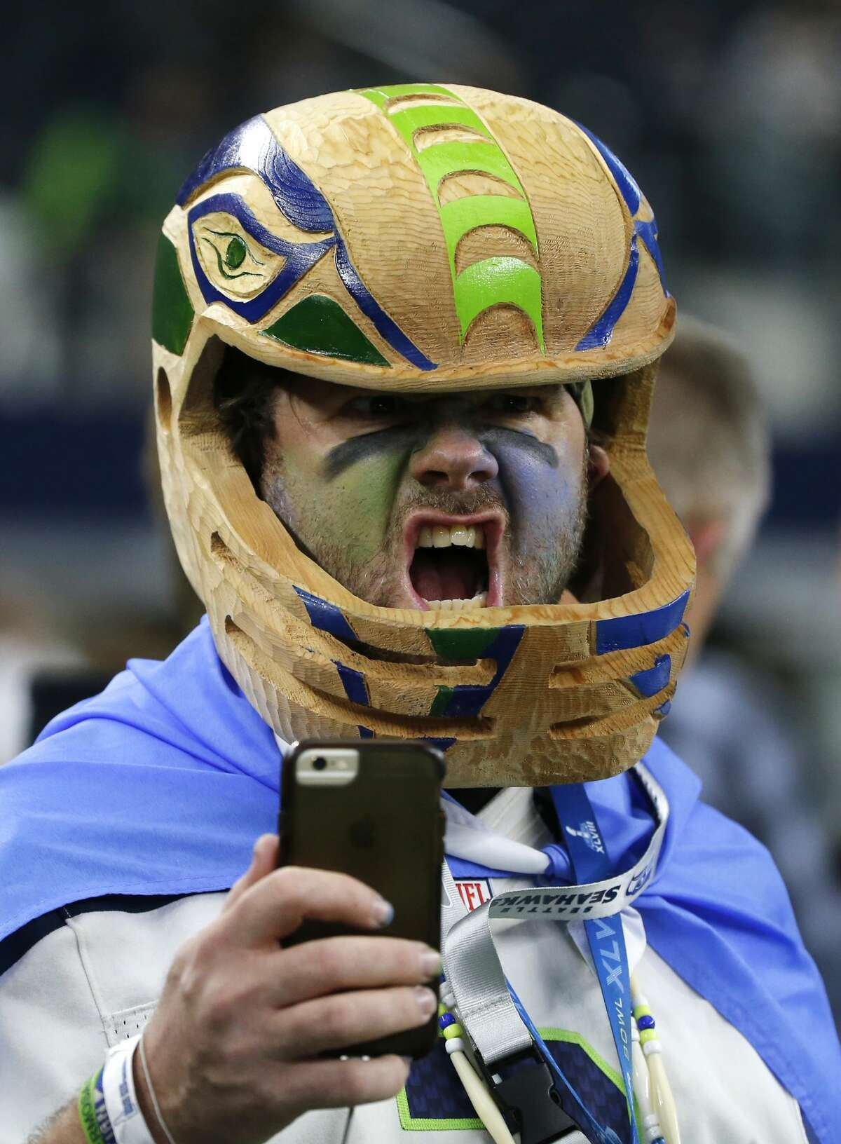 Christian Hill of Seattle takes his selfie as he stands on the field watching warmups before an NFL football game between the Seattle Seahawks and Dallas Cowboys on Sunday, Dec. 24, 2017, in Arlington, Texas. (AP Photo/Michael Ainsworth)