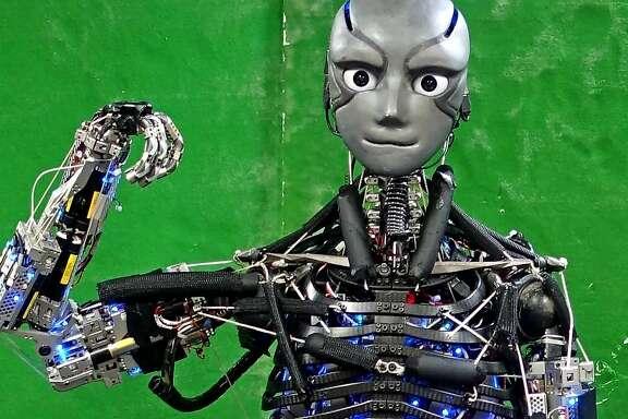 "Kengoro, a Japanese robot, flexes its ""muscle."" (Science Robotics)"