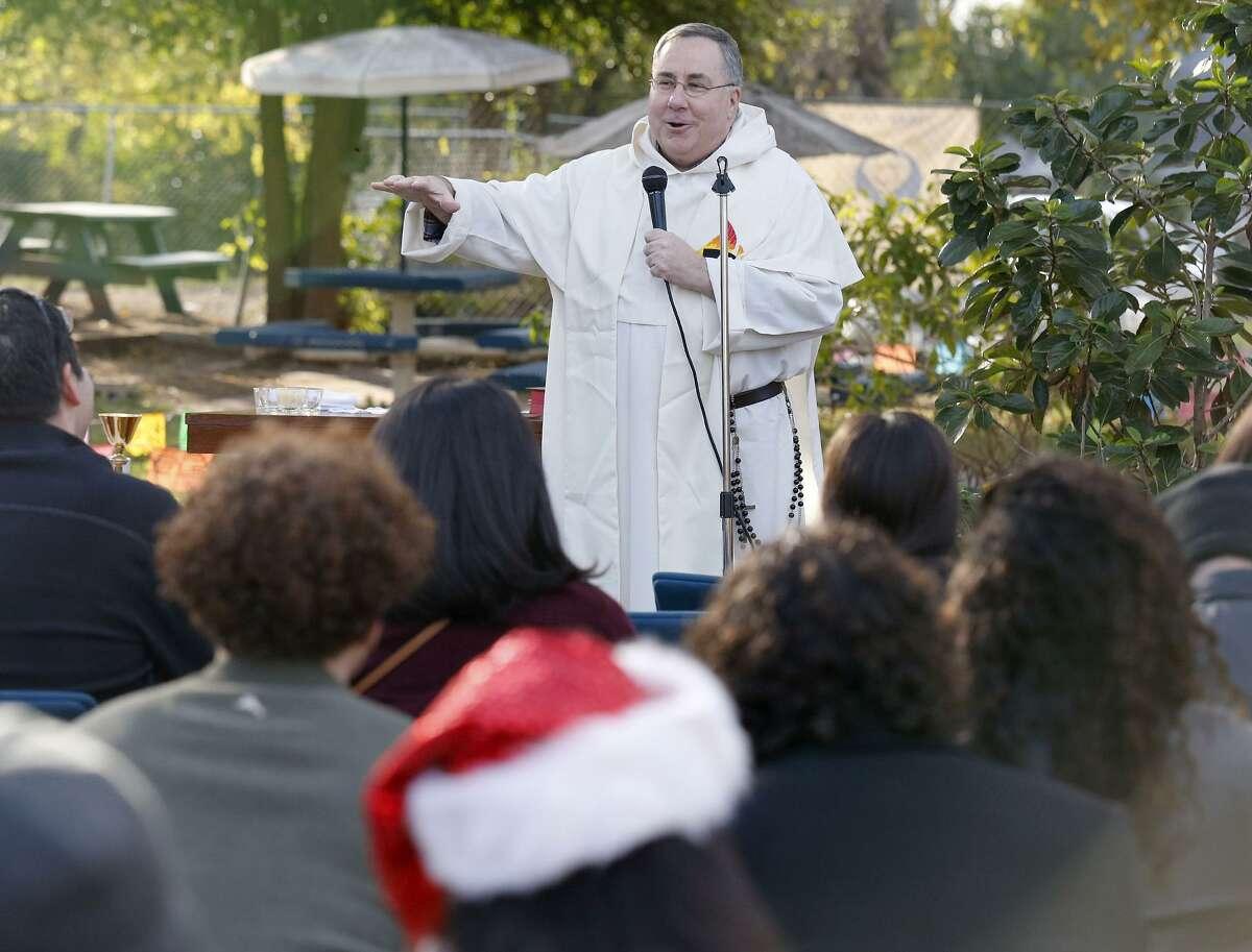 Father John Markey leads a mass Sunday Dec. 24, 2017 at the Catholic Worker House.