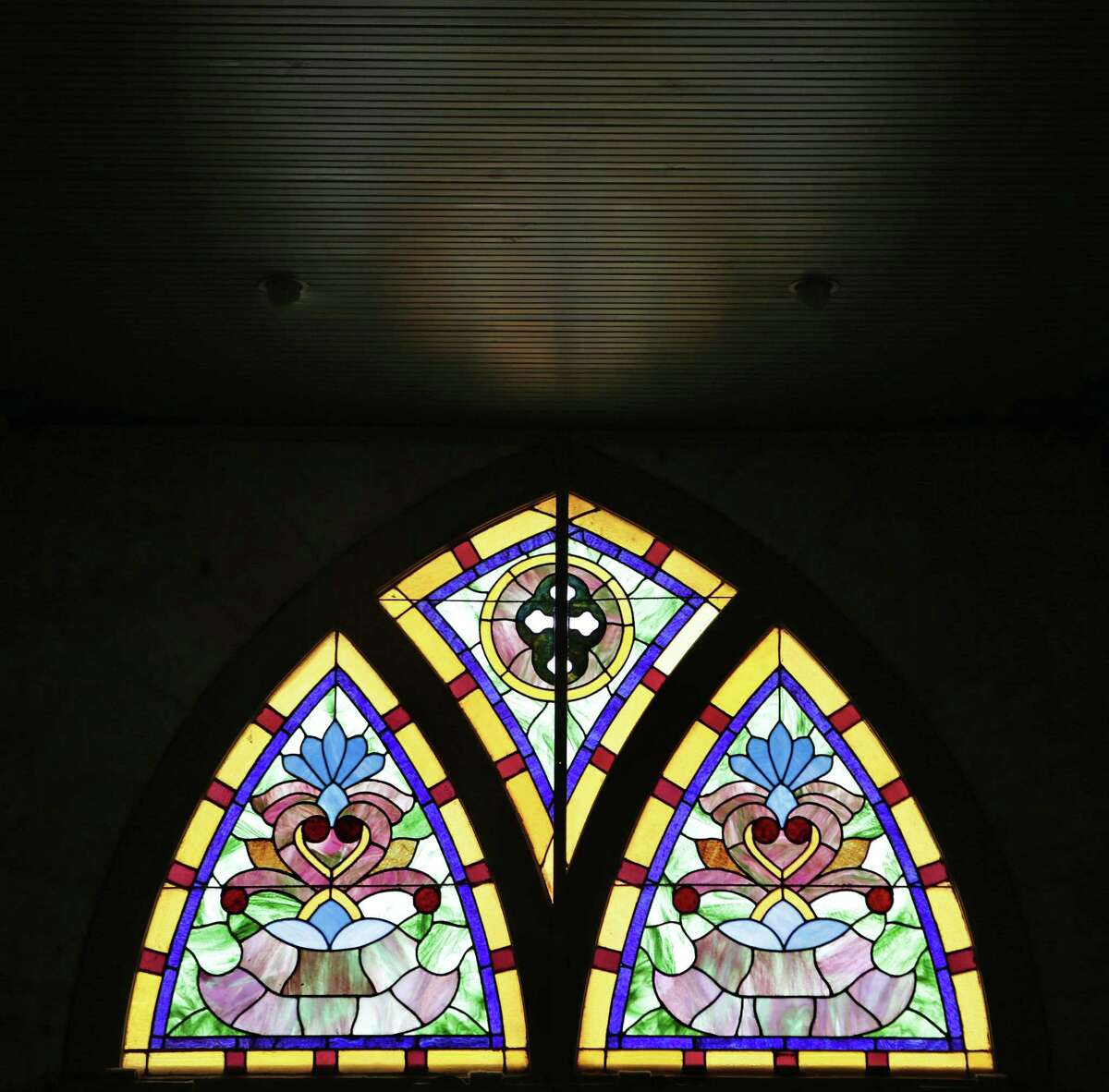 Stained glass window above the front entrance in San Fernando Cathedral.