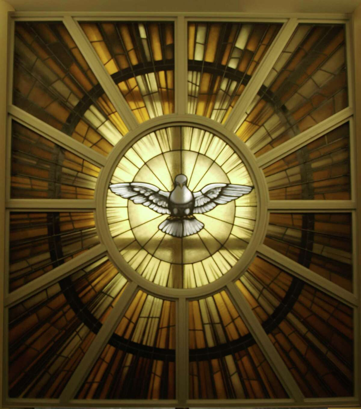 Stained glass of the Holy Spirit Dove atthe Pastoral Center of the Archdiocese of San Antonio, the work of San Antonio-based The Cavallini Co., Inc. Stained Glass Studio.