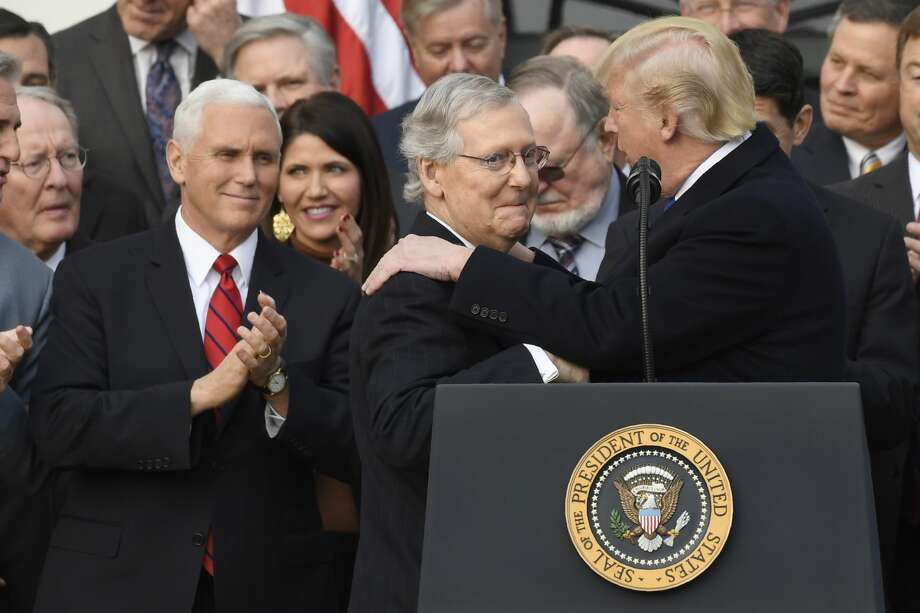 President Trump, Vice President Pence and Republican congressional leaders celebrate passage of tax reform. But, by a 52-32 percent margin in latest Quinnipiac University poll, Americans disapprove of the tax plan. Two-thirds believe its benefits flow mainly to the rich.  Photo: SAUL LOEB/AFP/Getty Images