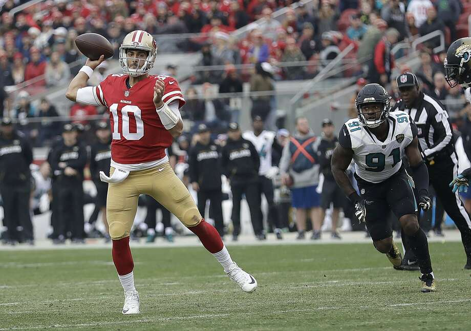 San Francisco 49ers quarterback Jimmy Garoppolo (10) passes against the Jacksonville Jaguars during the first half of an NFL football game in Santa Clara, Calif., Sunday, Dec. 24, 2017. (AP Photo/Marcio Jose Sanchez) Photo: Marcio Jose Sanchez, Associated Press